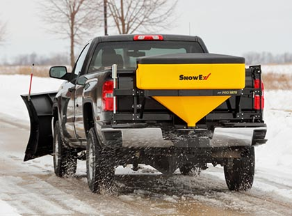 salt spreader attached to tailgate of truck