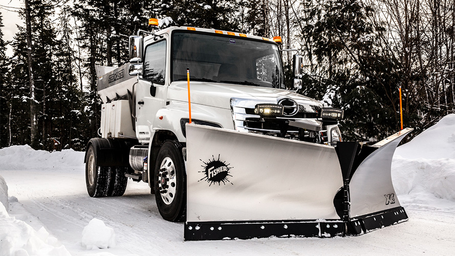 Yellow Fisher Plow attached to truck in snow